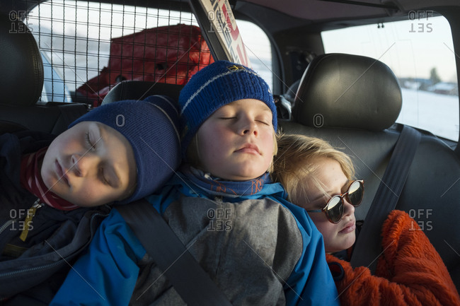 Children sleeping on backseat of car