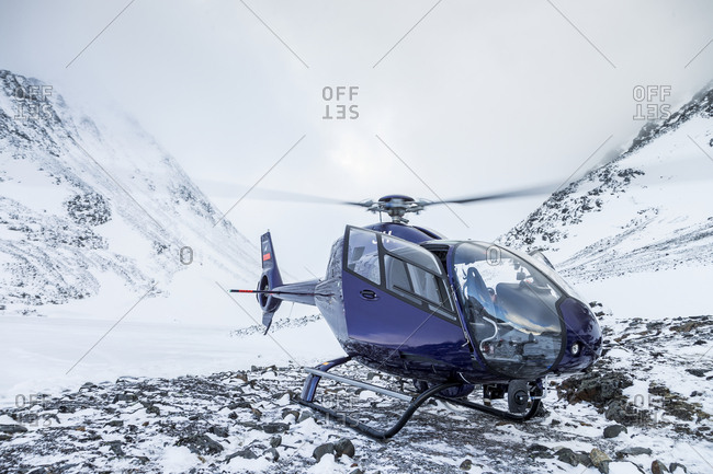 Helicopter in snowy landscape