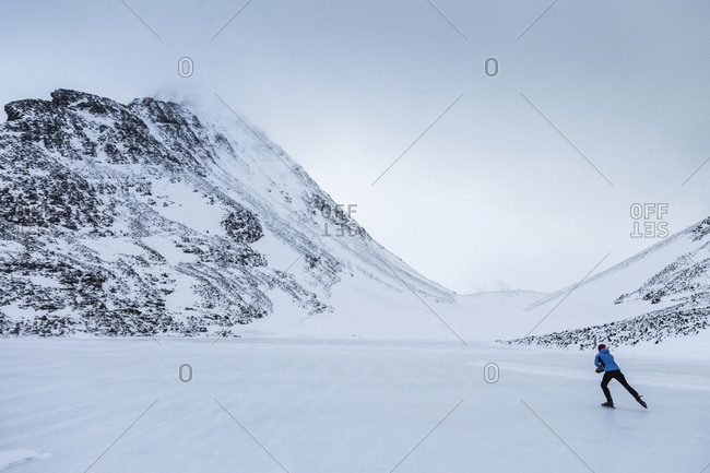 Person skiing in snowy landscape
