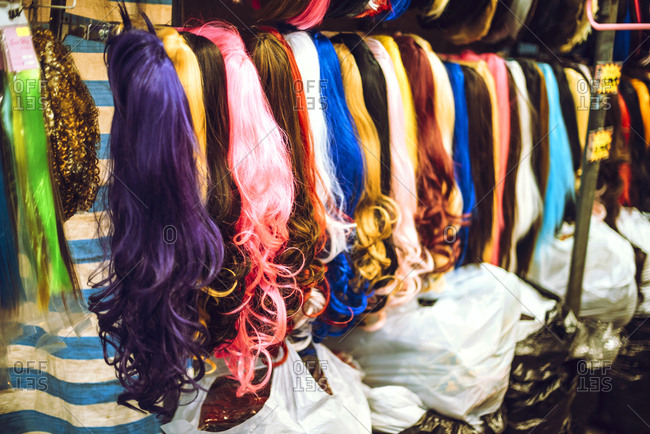A stand with different colored hair imitation, Horizontal outdoors shot,