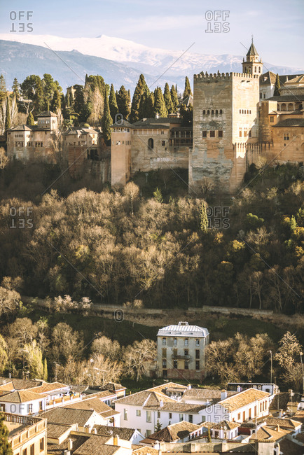 Ancient fortress Alhambra on hill in sun light, Granada, Spain,