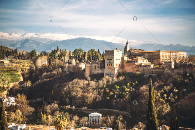 Beautiful view of Alhambra fortress in hill with mountains on , Granada, Spain,