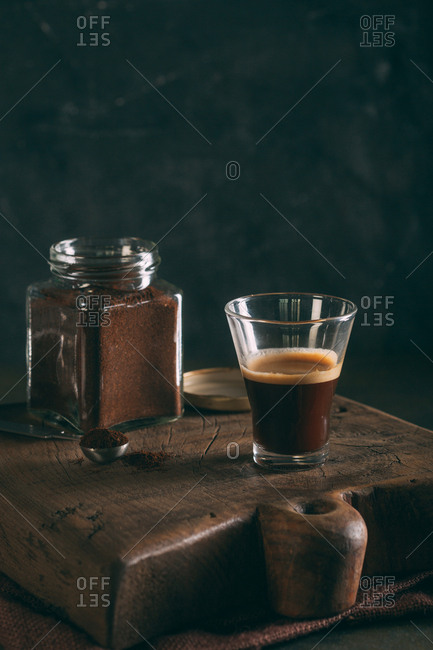 Black coffee in a glass on dark background