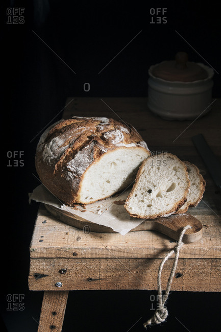 Bread slices on rustic table and dark background