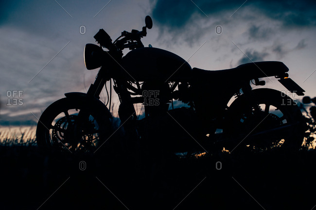 Cafe racer motorbike with sunset background