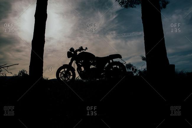 Cafe racer motorbike with sunset background