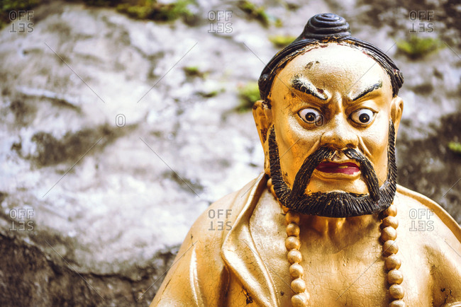 Close up of an old religious statue in a Buddhist temple
