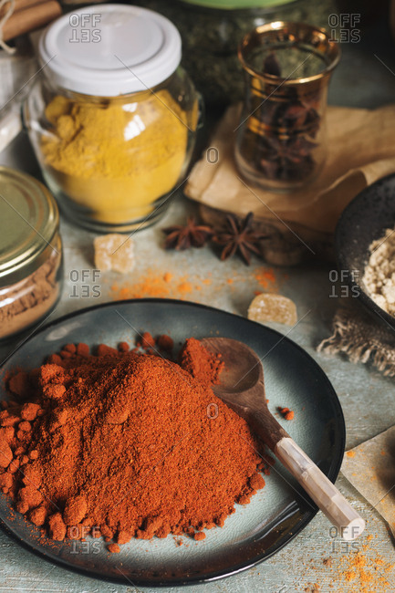 Different colorful spices, red pepper in a plate for cooking