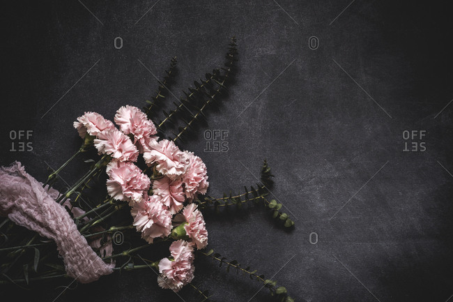 Flowers on black background, Flat lay, top view, Flowers background