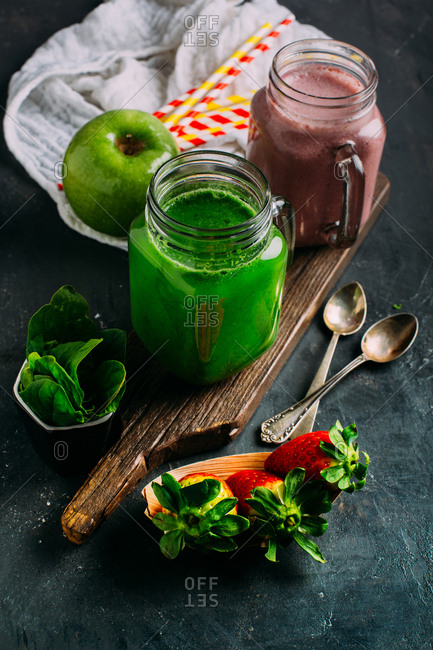 Green detox smoothie with apple and spinach and pink smoothie with berries