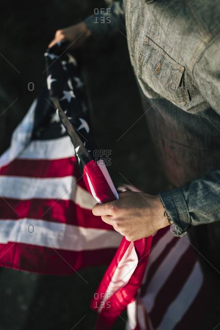 Man holding a US Flag