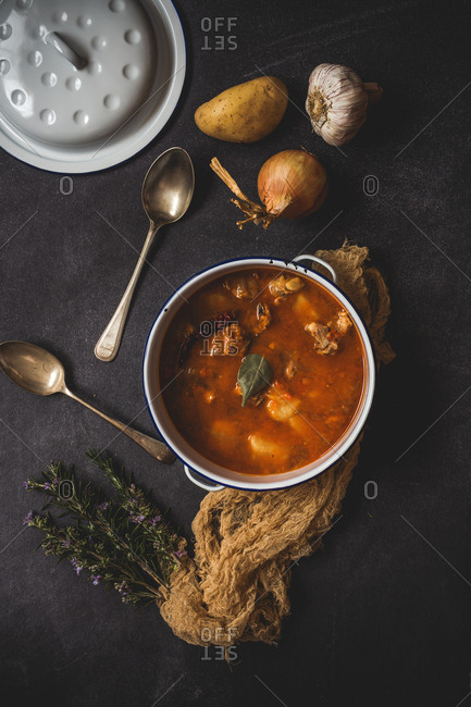 Pork stew with vegetables with napkin on old table