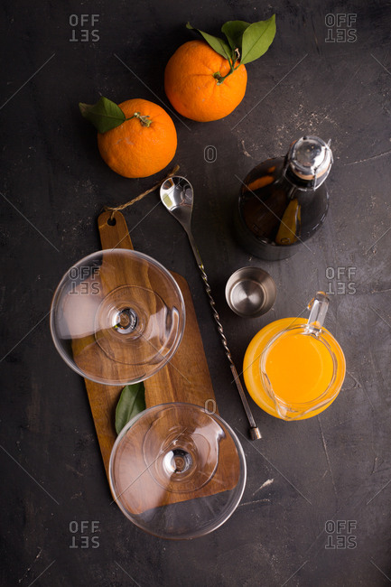 Preparing mimosa cocktail with champagne and orange juice