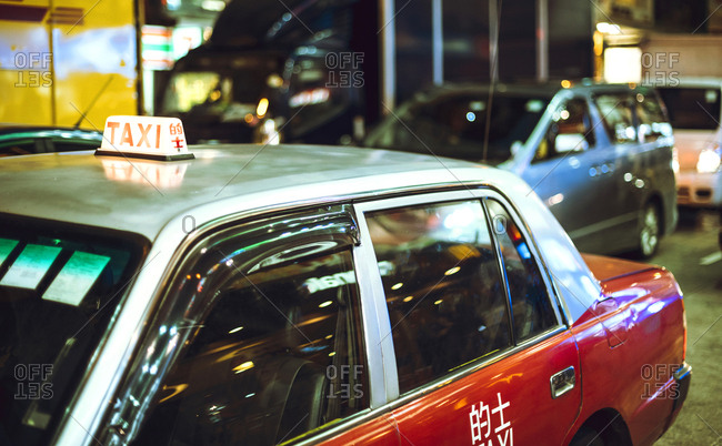 Red taxi car in the evening in Hong Kong street, Horizontal outdoors shot,