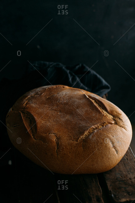 Rustic bread loaf on dark background