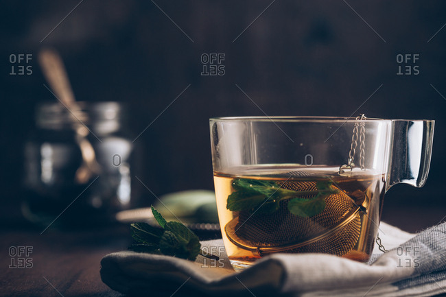 Steaming cup of tea on dark background