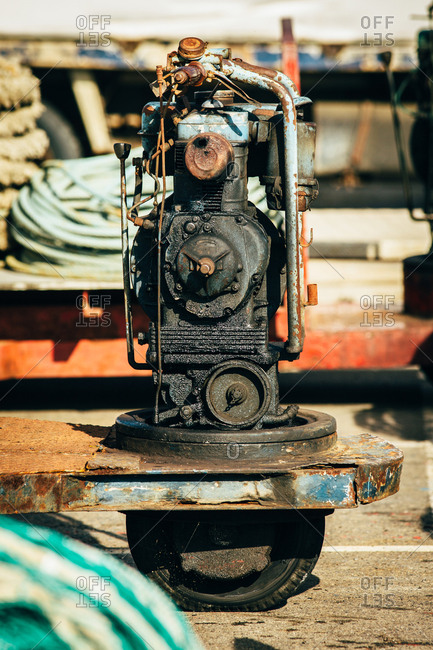 The heavy old device on a rusty truck in Palamos, Spain, Vertical outdoors shot,