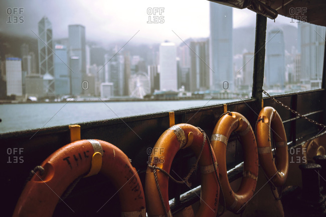 The skyscrapers of Hong Kong in background while ferry boat sail,