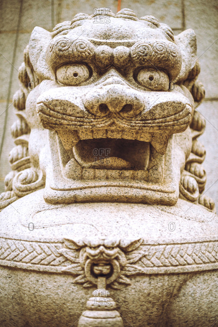 Traditional figure made with stone in Hong Kong, Vertical outdoors shot,