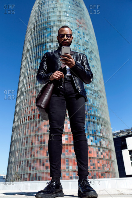 Trendy man using smart phone