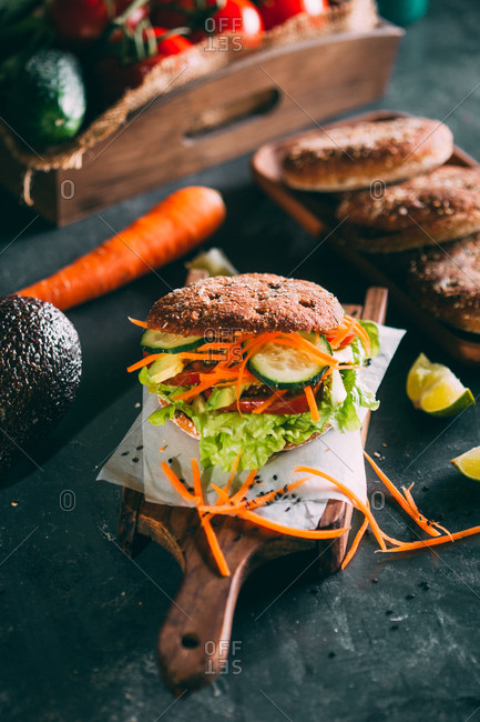 Vegetarian sandwich with lettuce, cucumber, carrot tomato and avocado