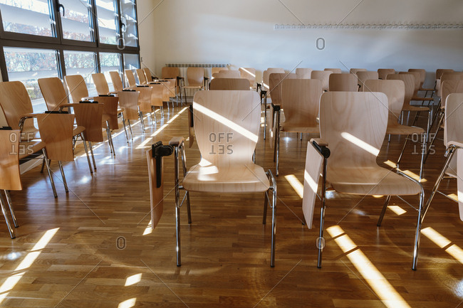 Wooden seats in the lecture hall, Horizontal indoors shot,