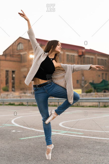 Young girl performing a ballet on a playground, Vertical outdoors shot,