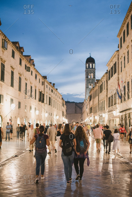 Dubrovnik, Croatia - February 4, 2017: Tourists walking at dusk on Placa street in Dubrovnik, Croatia