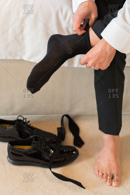 Groom putting his socks on