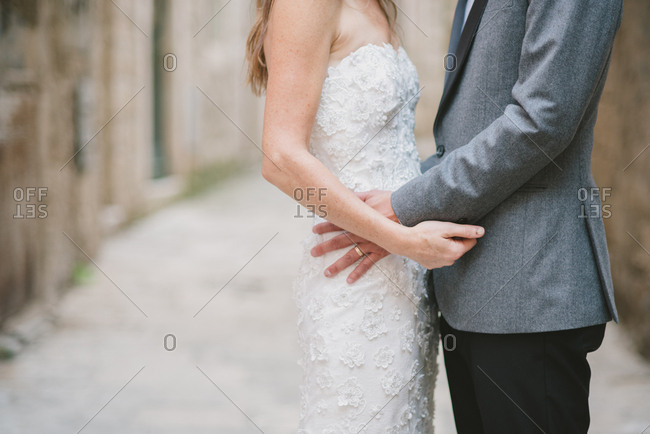 Groom and bride embraced outdoors