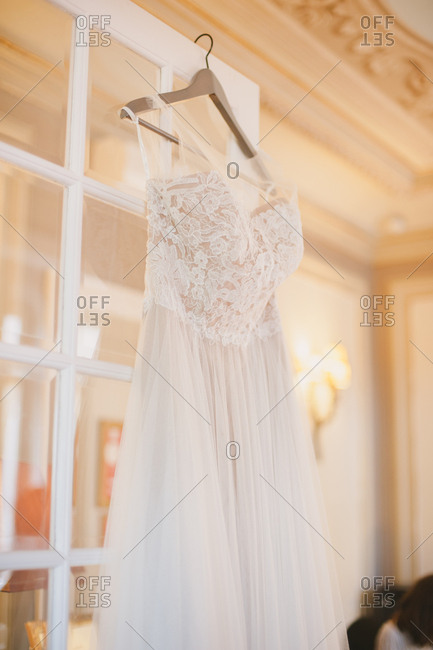 White wedding gown on a wooden hanger