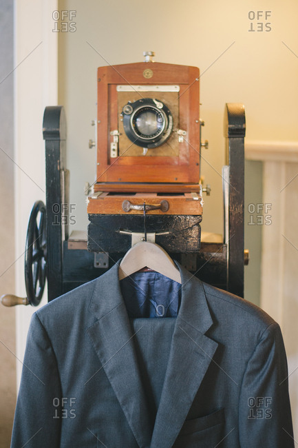 Sintra, Portugal - February 4, 2017: Groom's suit hanging on antique wooden camera