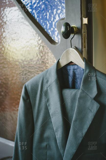 Sintra, Portugal - February 4, 2017: Groom's suit hanging on doorknob