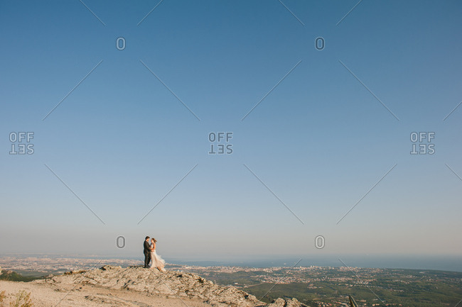 Sintra, Portugal - February 4, 2017: Bride and groom standing on top of the Sintra Mountains