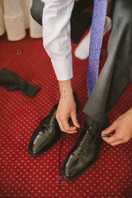 Sintra, Portugal - February 4, 2017: Groom tying his black shoes