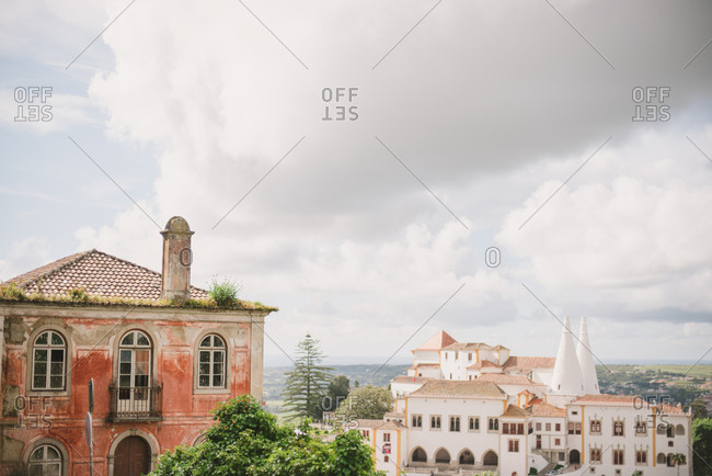 Buildings in the town of Sintra, Portugal under cloudy sky