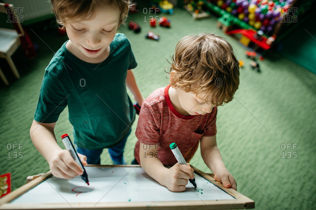 Children having fun writing on a drawing board