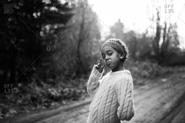 Girl standing on dirt road in black and white