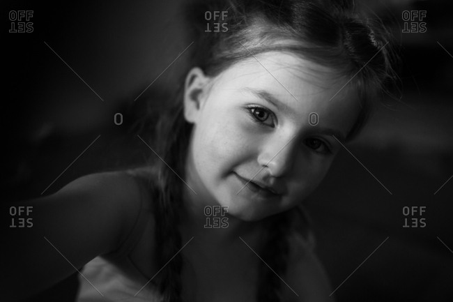 Black and white portrait of a little girl with braids