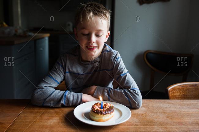 Boy with birthday doughnut