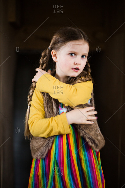 Little girl with braids and a colorful outfit