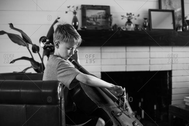 Boy practicing the cello