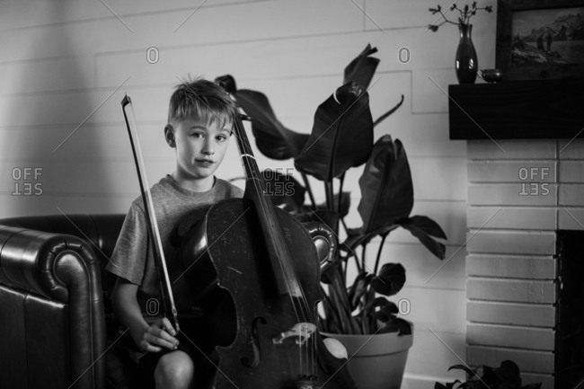 Boy sitting with his cello
