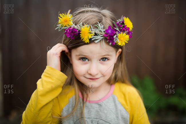 Portrait of a little girl wearing floral crown