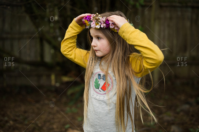 Little girl wearing floral crown