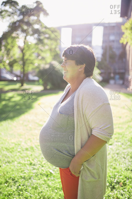 Pregnant woman laughing