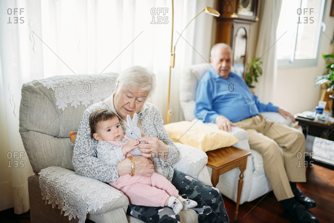 Great grandparents taking care of their great granddaughter