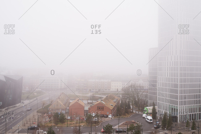 Malmo, Sweden - March 28, 2017: Buildings in Malmo, Sweden under foggy sky