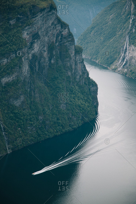 Boat traveling by staggering cliffs