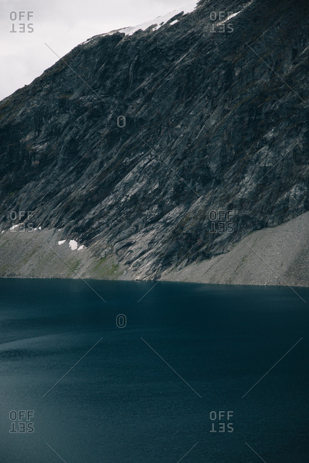 Steep cliff into water